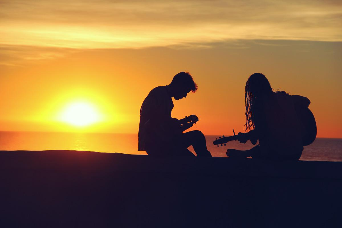 couple playing guitar at sunset motivational quotes