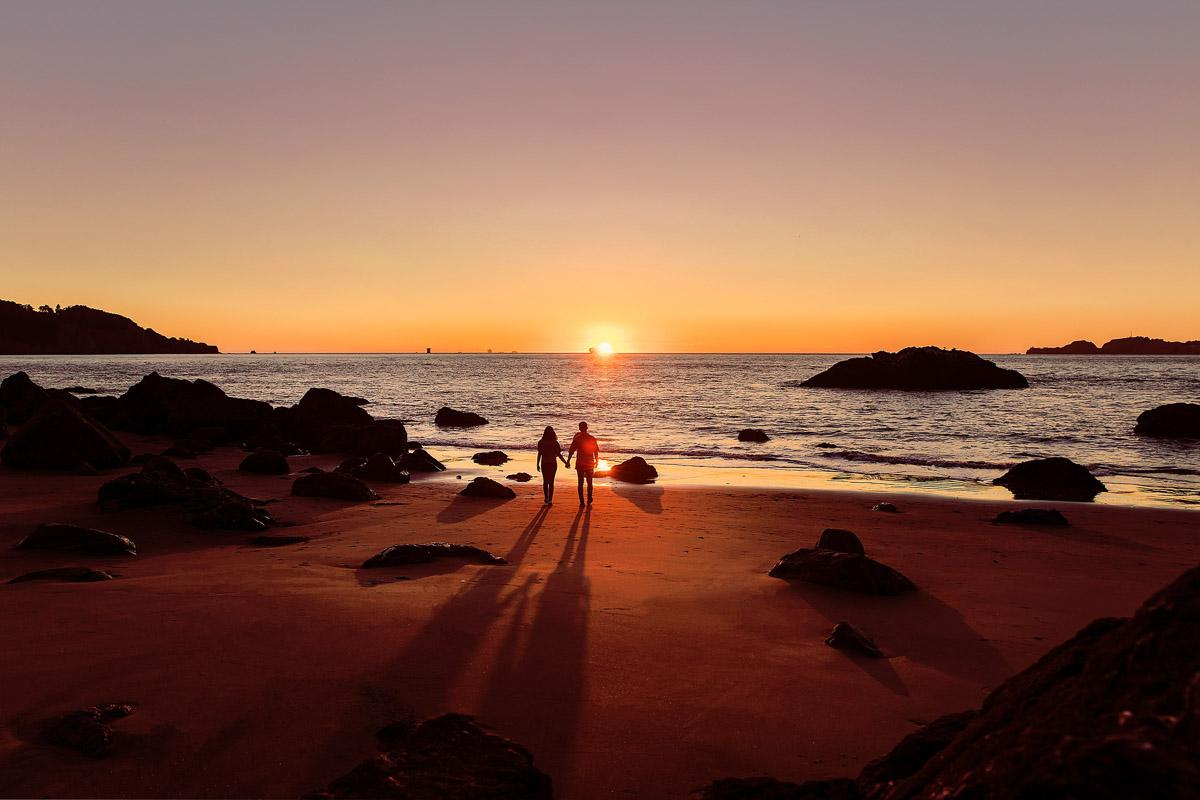 couple walking on the beach at sunset quotes love