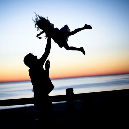 father throwing kid at sunset captions funny