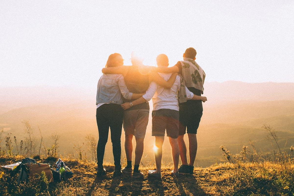 four friends watching the sunset photo captions