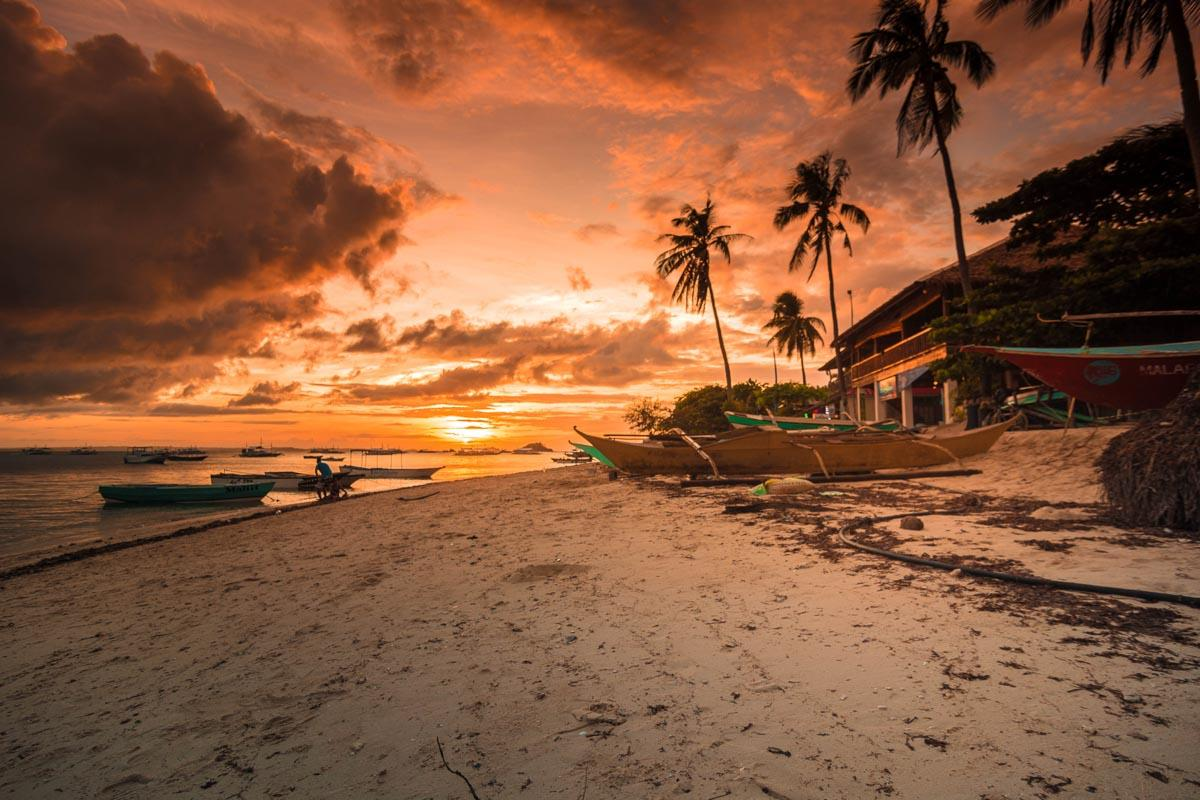 golden sand beach with a sunset beach captions