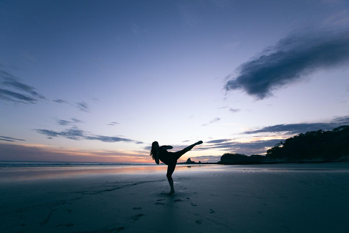 karate kick on the beach at sunset good captions for sunsets