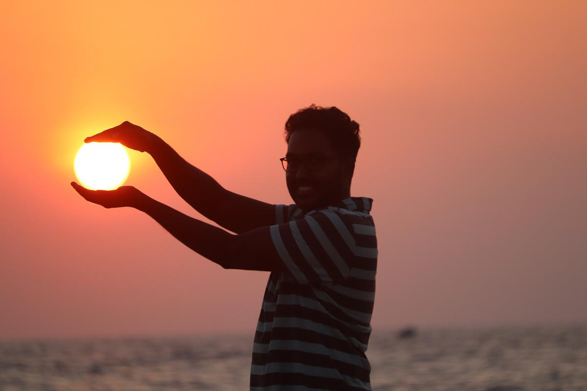 man catching the sunset and laughing at sunset funny captions