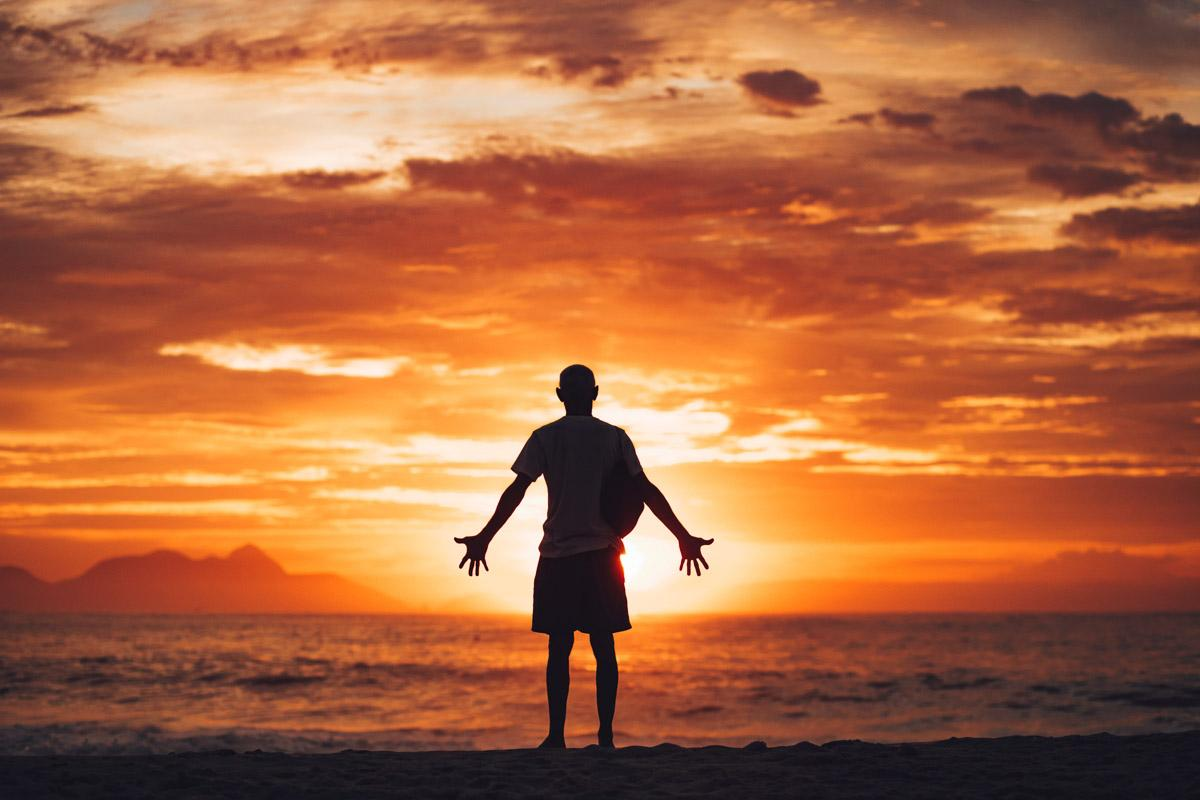 man facing the sunset with arms open wide life sunset quotes