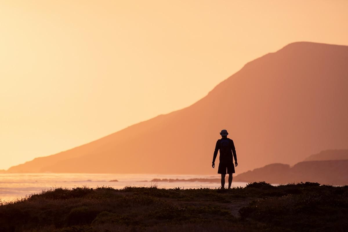 man in nature in front of mountain sunset quote