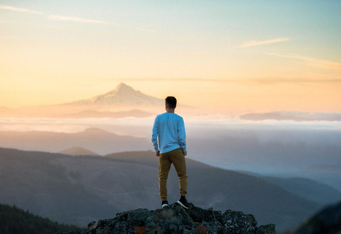 man on top of mountain at sunset quotes inspirational