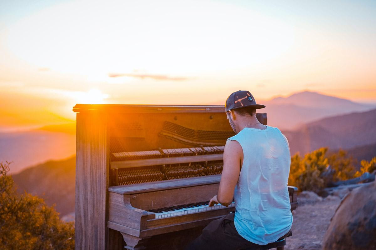 man playing piano at sunset instagram captions