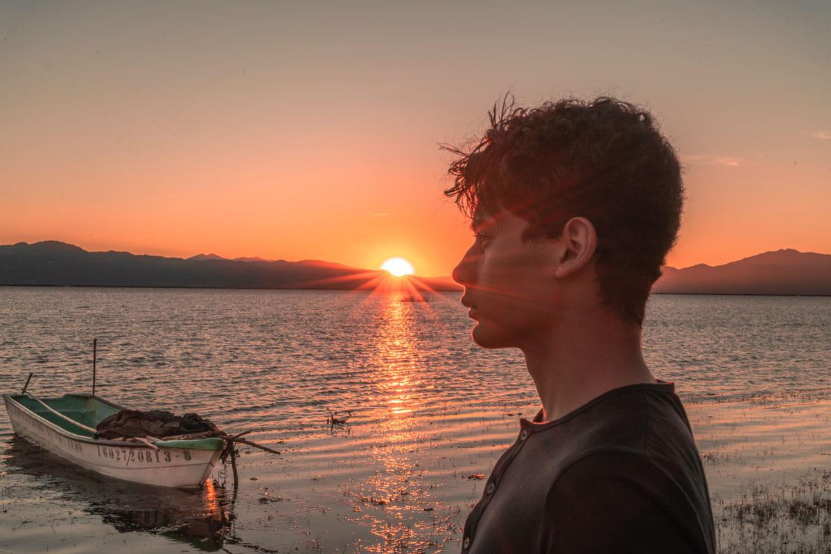 sad boy at sunset captions