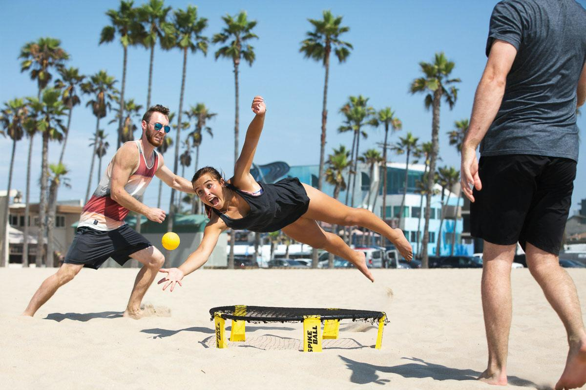 spikeball on the beach girl jumping beach quotes funny beach captions for instagram