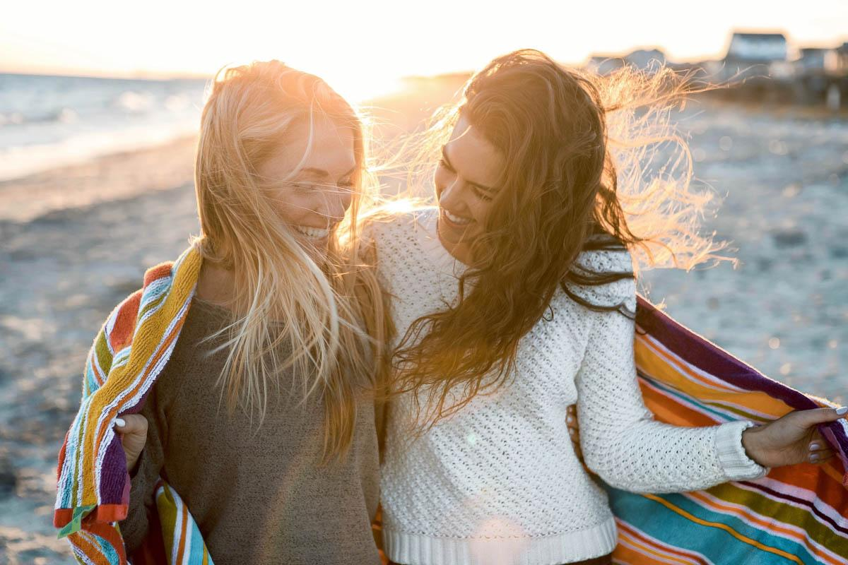 two girls friends laughing during sunset best caption for sunset