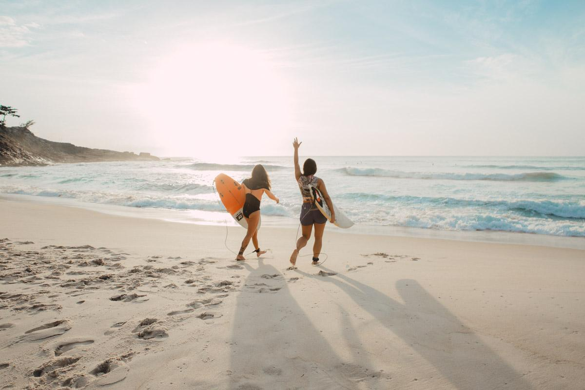 2 women surfers on the beach short beach quotes and short beach captions