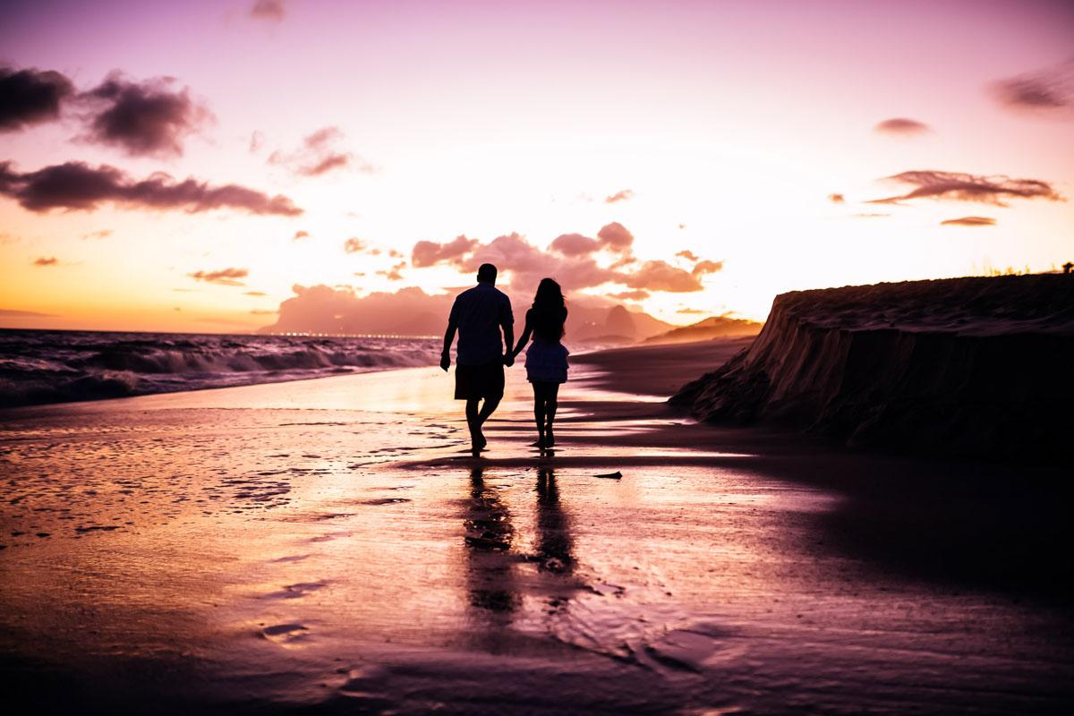 couple walking on the beach at sunset long walk on the beach quotes