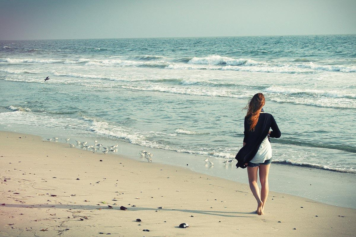 girl walking barefoot on sand beach walk in the beach quotes