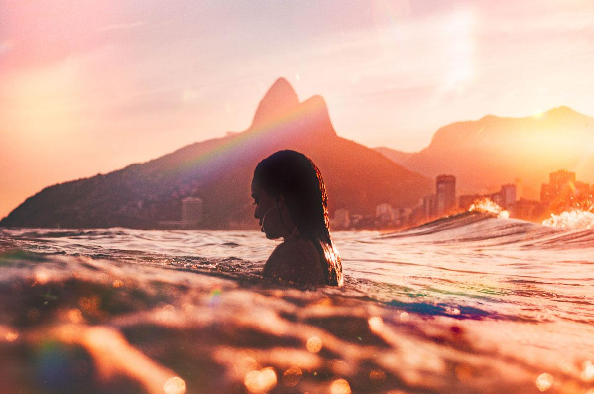woman in the sea during sunset simple short beach captions for instagram
