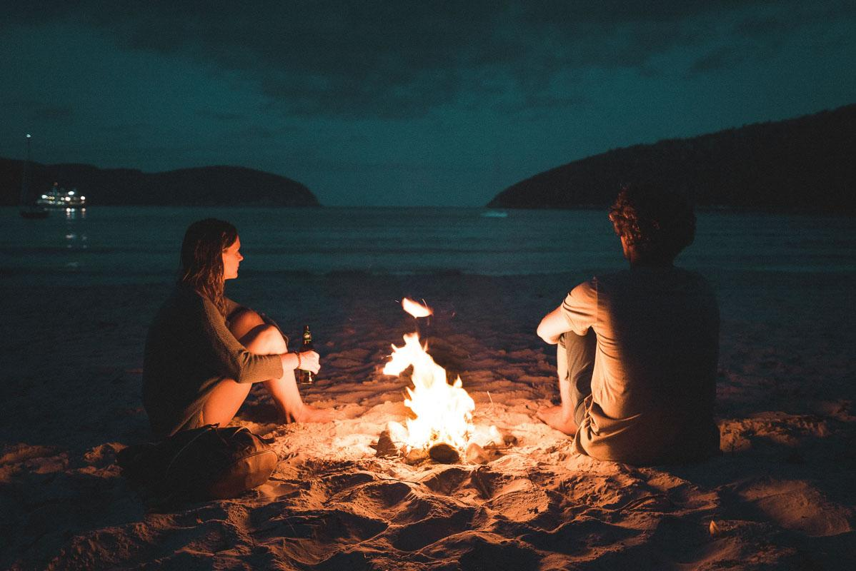 couple in front of fire on beach at night quotes