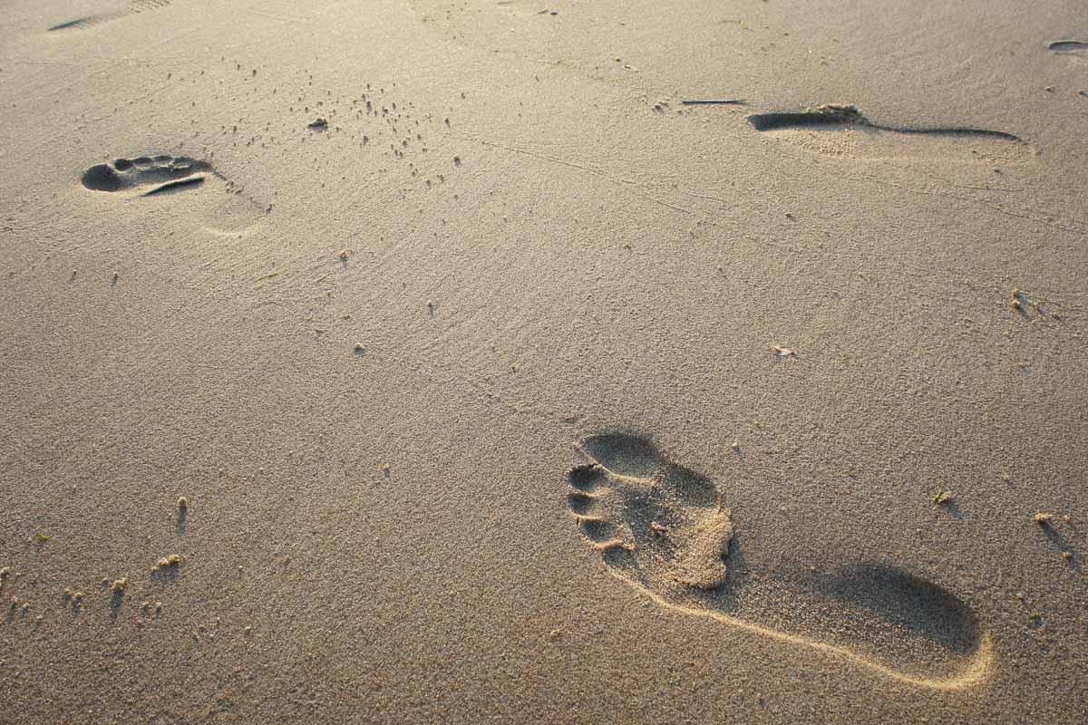 footprint on sand beach captions insta