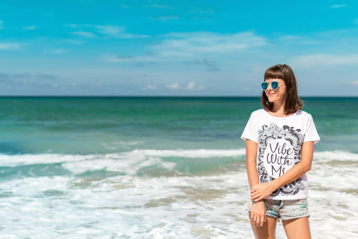 girl on the beach with vibes t shirt beach vibes captions