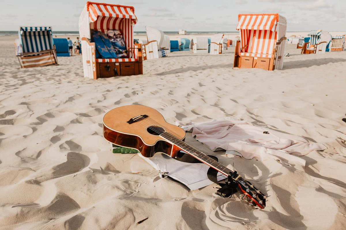 guitar on a beach captions about the beach