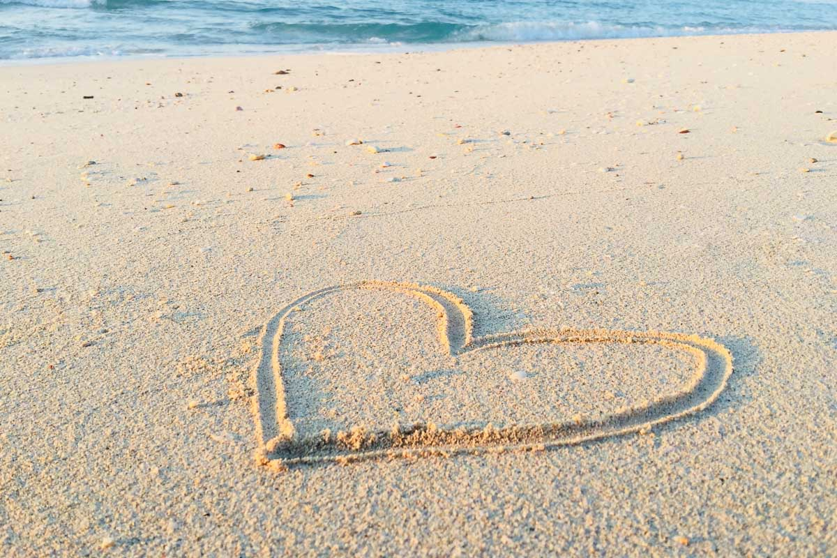 i love the beach heart in sand instagram beach caption for a beach picture