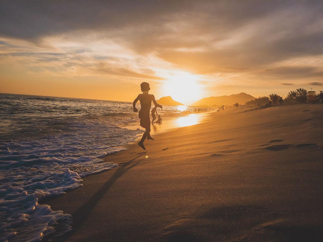 little boy playing in the waves beach pic captions
