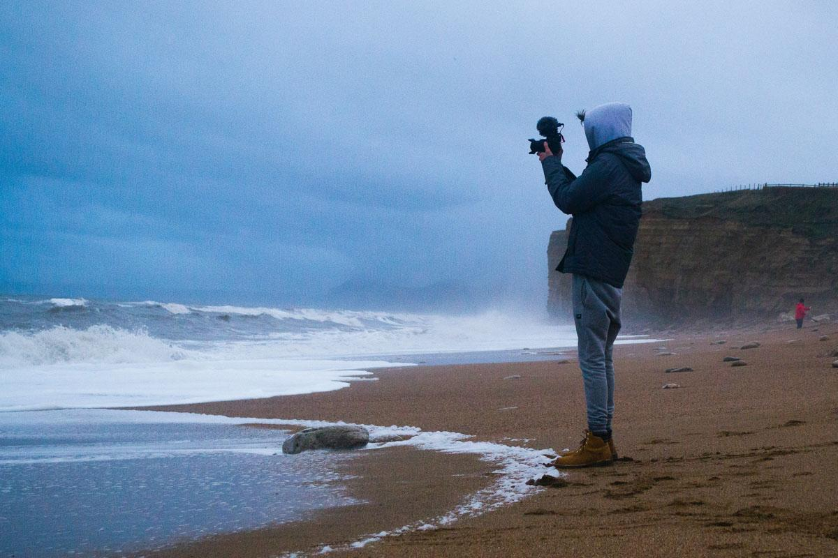 man filming the beach caption for beach pictures