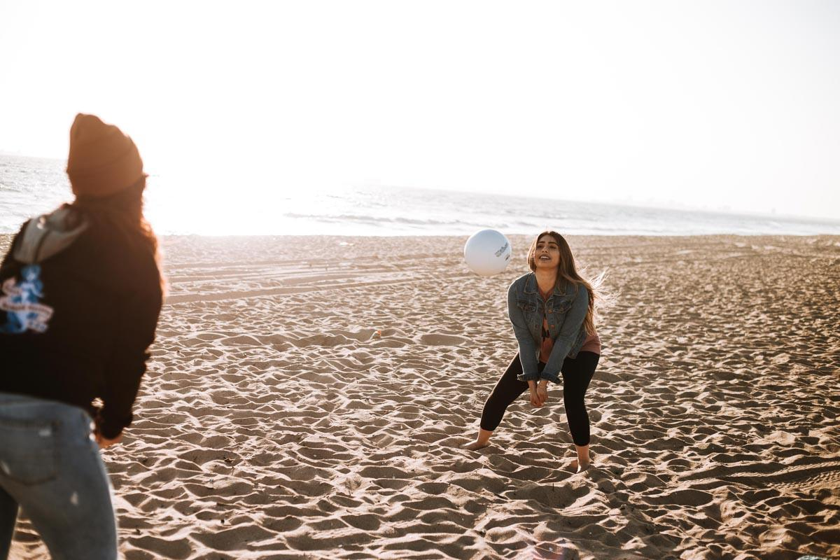 two girls play volleyball on the beach caption for beach photos